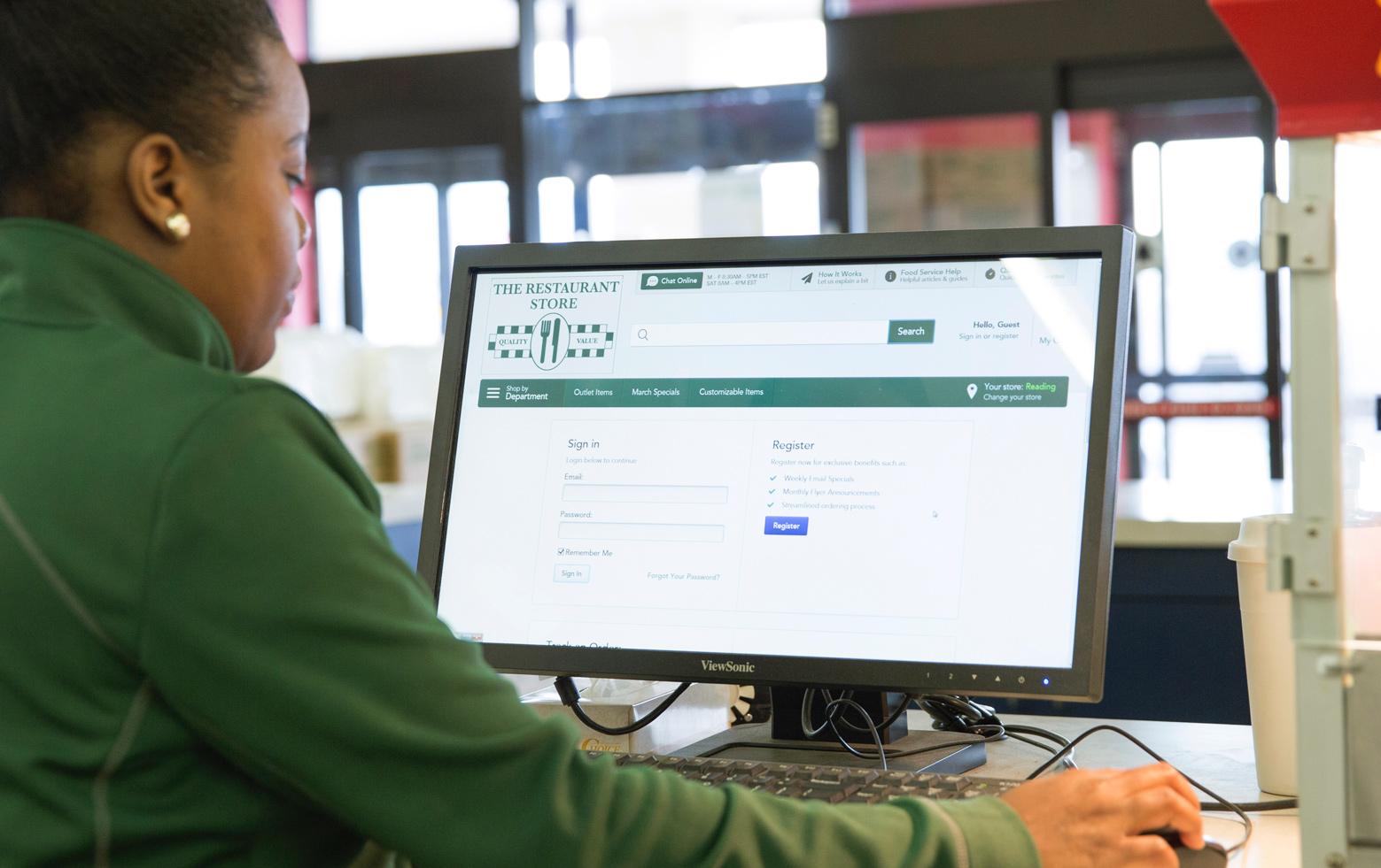 A The RestaurantStore employee on the computer